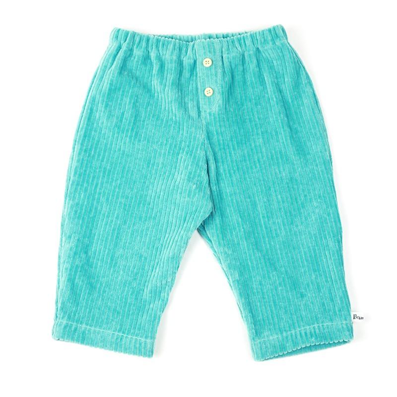 Pantalon bébé garçon coloris bleu vert en velours grosses côtes, très mode.