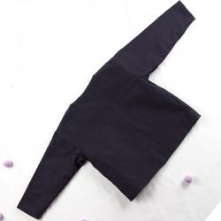 Dos de la veste fillette en tissu biologique façon artisanale.