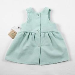 Vue de dos, la robe fillette création couture  fabrication artisanale et soignée.