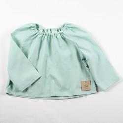 Tissu biologique pour fabriquer cette blouse de bébé de façon artisanale