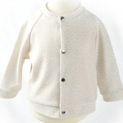 Veste bébé tissu bio overlock pois blancs sur fond beige