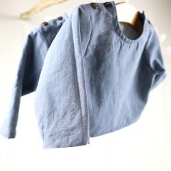 Tissu biologique pour fabriquer cette blouse jean résistante façon artisanale.