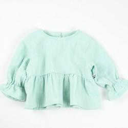 Création originale pour cette blouse fille lange coton bio spécial bébé.