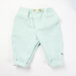 Coupe originale pour ce pantalon créateur en lange de coton organique coloris menthe.