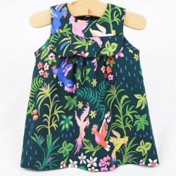 Robe bébé jardin d'Eden en coton organique avec plastron.