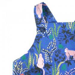 Barboteuse mixte jardin bleu adorables petits singes sur fond végétal.